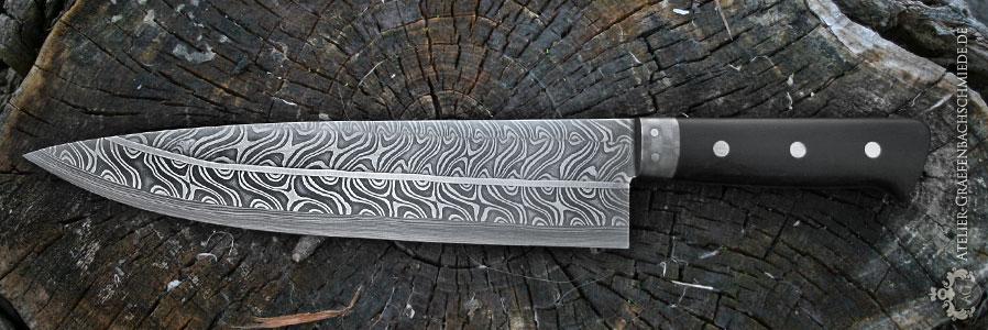 Küchenmesser wurmbunter Aufbau 320 Lagen Torsion-Zwischenlage und senkrechte Damastschneidlage